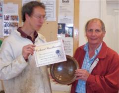 The monthly winner Howard Overton received his certificate from Tobias Kaye