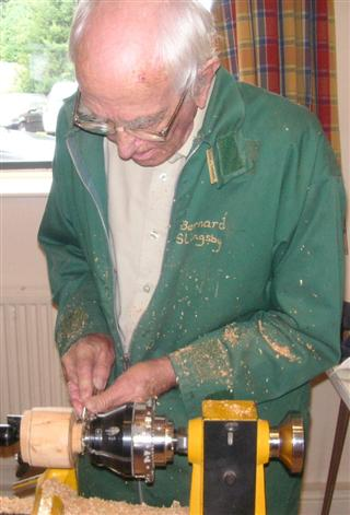 Bernard showing how he makes his clocks