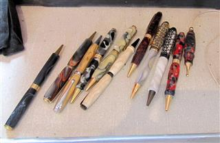 A sample of Bernard's pens and light pulls