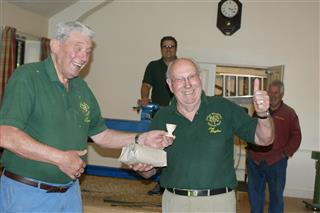 Bert presenting the winners prize to Pat Hughes for the speed turning competition