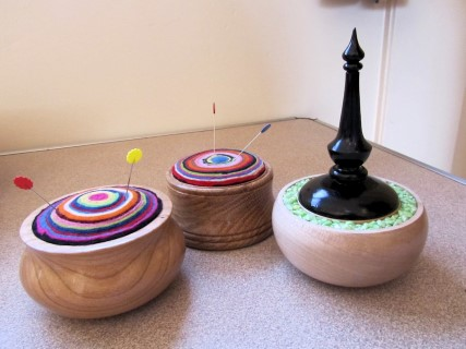 Two pin cushions and a pot by Len Laker