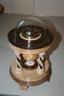 Ian Alstons winning piece<br>a sundial and a clock mounted in a colonnaded setting