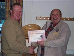 The monthly winner Tony Handford receiving his certificate from Peter Blake
