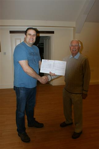 Paul presents a cheque for �150 raised for Sittingbourne MS to Smith Adams