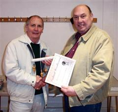 The monthly winner Howard Overton received his certificate from Peter Blake