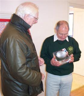 Peter Fuller presents the Bill Alston memorial trophy to turner of the year Howard Overton