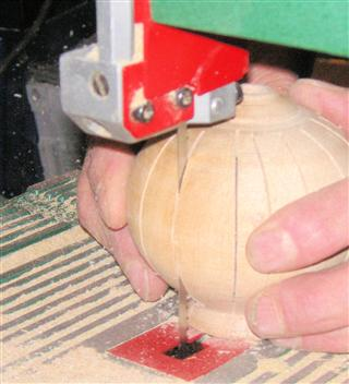 Cutting the slots in the side of the pomander