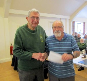 Bert gave Alan a voucher for his work in preparing the hall each club day