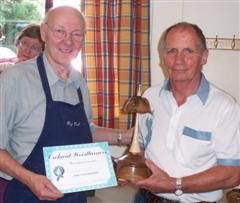 Runner up Howard Overton receives his certificate from Reg slack
