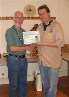 The monthly Highly commended Arthur Clatworthy received his certificate from Gary Rance