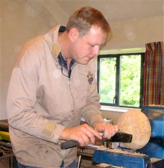Simon shear scraping a final finishing cut to his first piece of the day