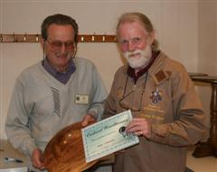 The monthly Highly commended Geoff Hunt received his certificate from Stephen Cooper