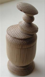 Peter's finished oak pot with a wobbly lid