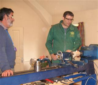 Paul demonstrating screw cutting to Matthew
