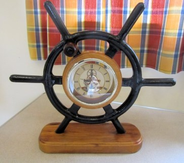 Clock set into aluminium ships wheel by Pat Hughes