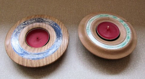 Pair of decorated tea lights holders by Paul Hunt