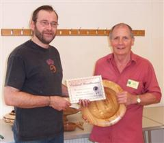 The monthly winner Howard Overton received his certificate from Mark Hancock