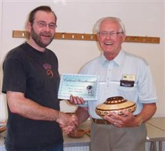 The monthly Highly commended Frank Hayward received his certificate from Mark Hancock