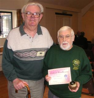 The highly commended winner Norman Smithers received his certificate From Wolf Schulze