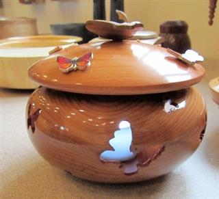 Pierced and decorated butterfly lidded pot by David Reed