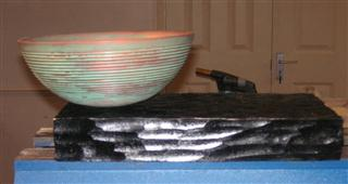 Mark's bowl displayed on a black stand