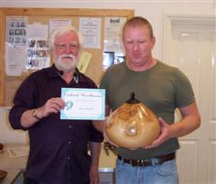The monthly Highly commended Tony Handford received his certificate from Mervyn Firmager