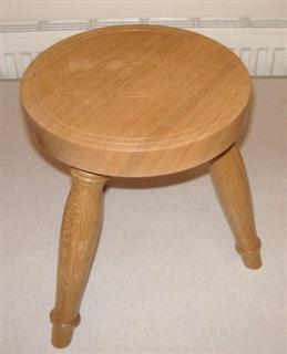 Oak three legged stool by Norman Smithers