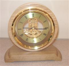 Skeleton clock set in oak by Graham Holcroft